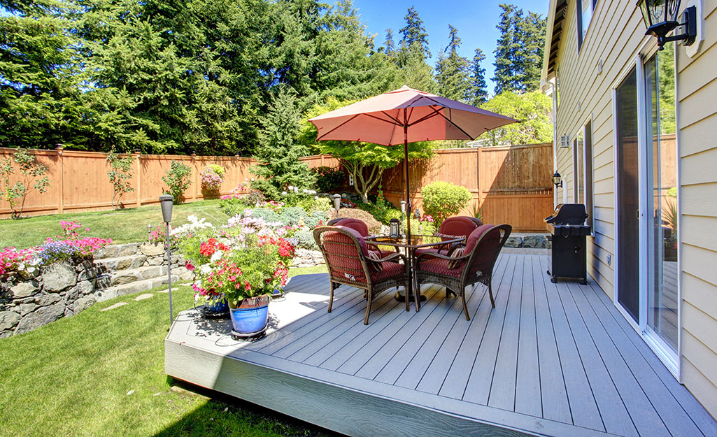 Patio furniture on a backyard deck.