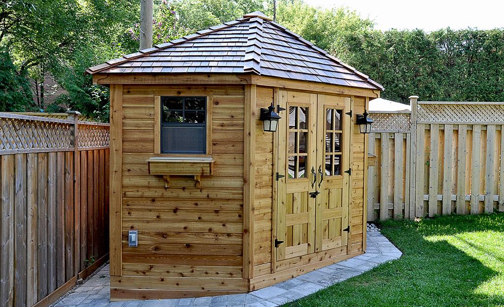 Wood storage building in a backyard