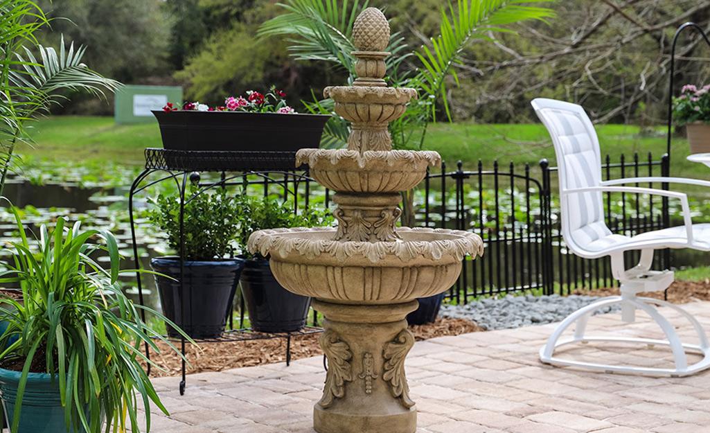 A stone fountain on a patio.