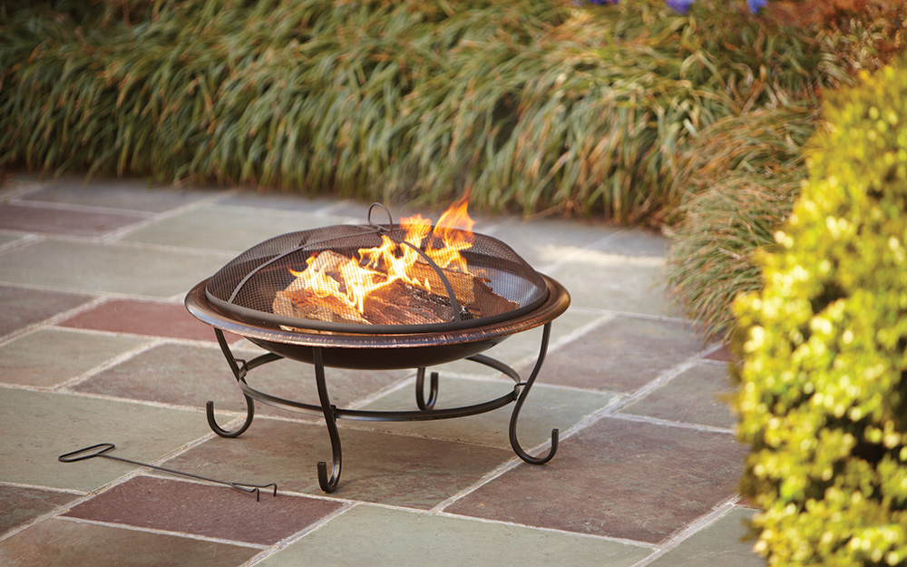 A round fire pit on a patio.