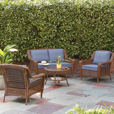 a backyard patio with a conversation set