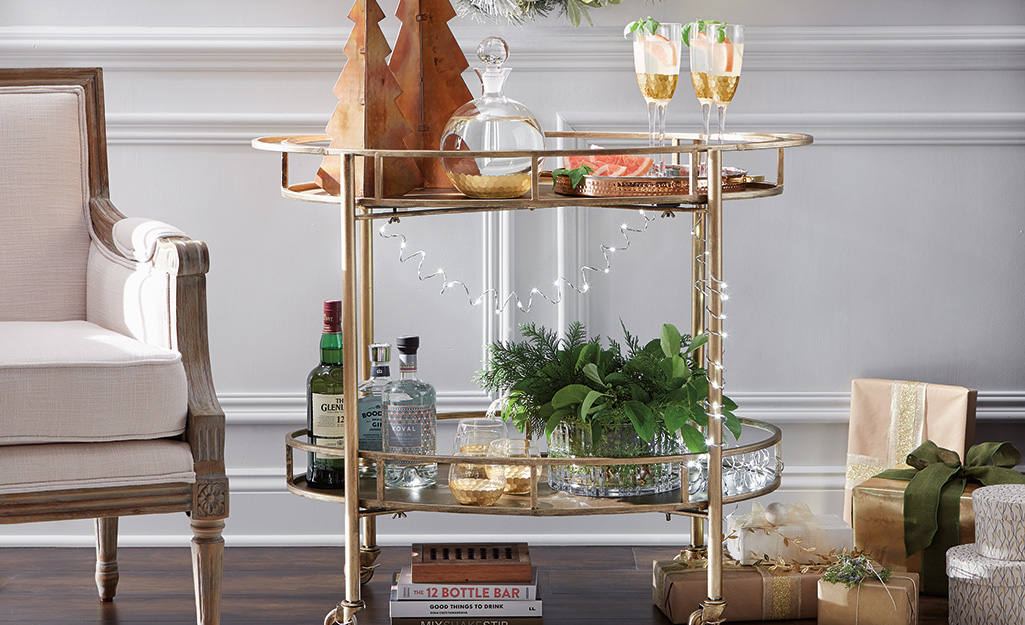 A bar cart decorated with string lights.