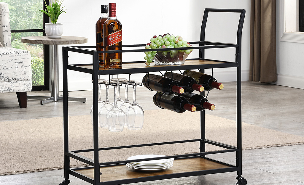 A bar cart with a built-in wine rack and under-shelf storage for stemware.