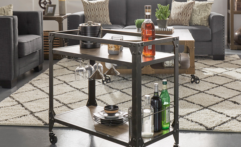 A bar cart with an industrial look and under-shelf storage for glassware.