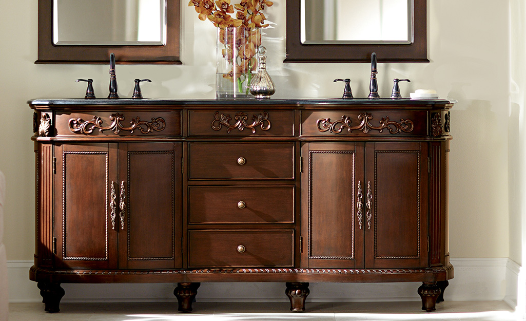 A furniture-style double vanity in a dark wood finish. - Types of Bathroom Vanities and Sinks
