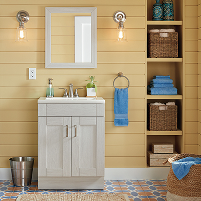 a clean, bright bathroom with built-in storage shelves beside a sink