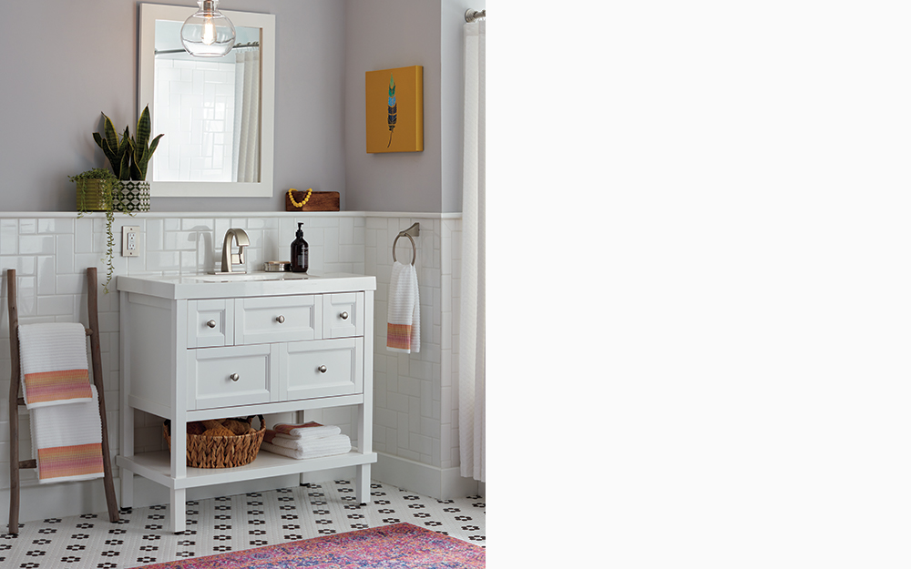 Bath vanity styled with global decor and vibrant colors.