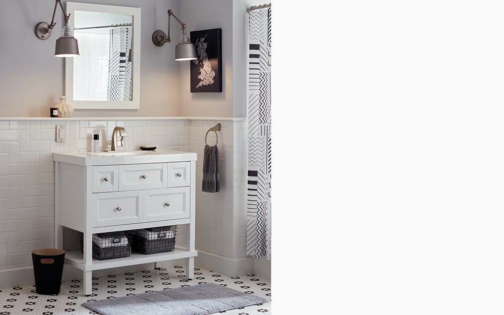 Bath vanity styled with modern decor including black, white and grey details.