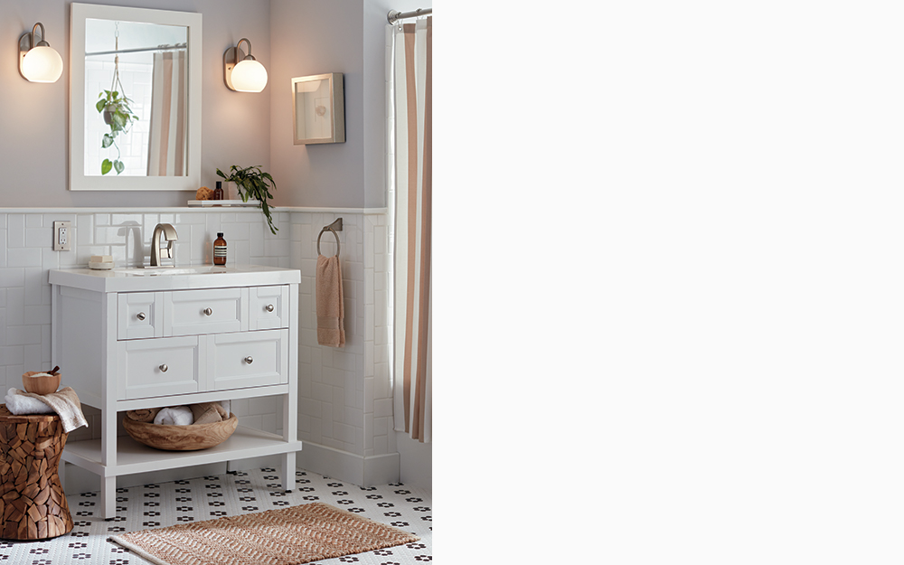 Bath vanity styled with a focus on natural materials like wood and texture.