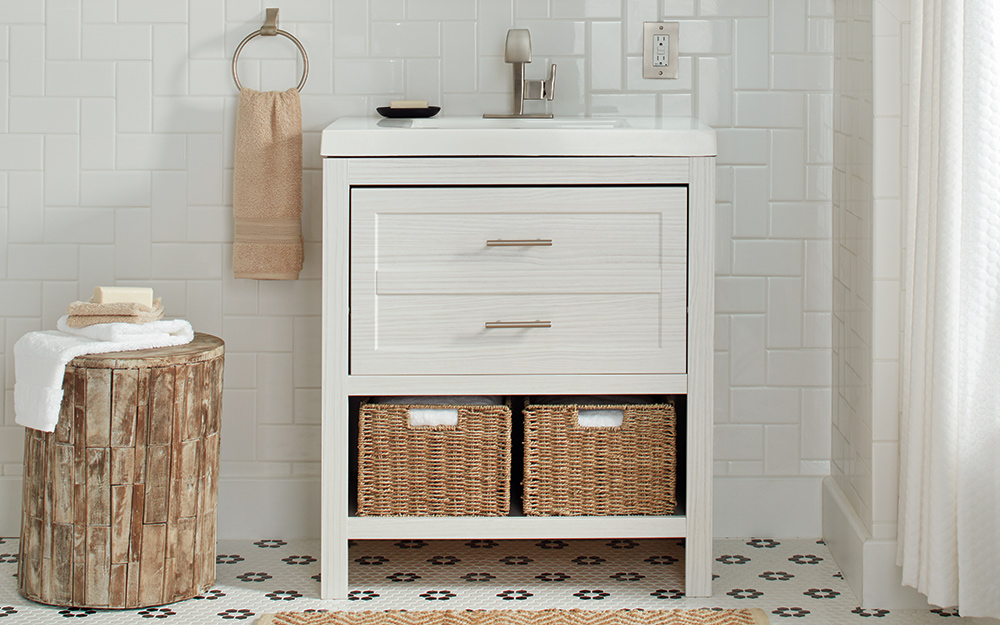 A white vanity with an open bottom shelf. - Types of Bathroom Vanities and Sinks