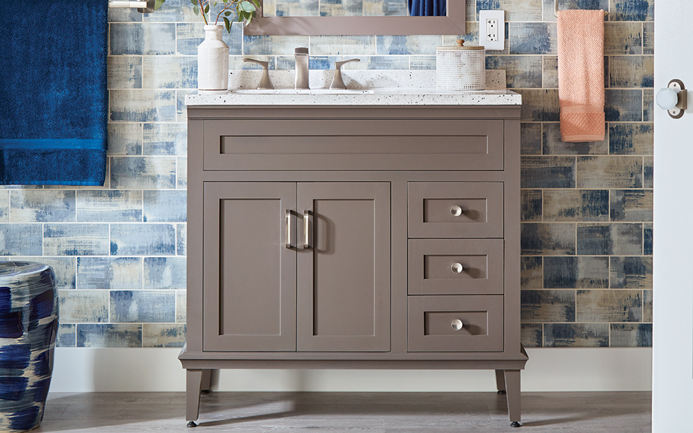 A single sink bathroom vanity  in a darker finish.- Types of Bathroom Vanities and Sinks