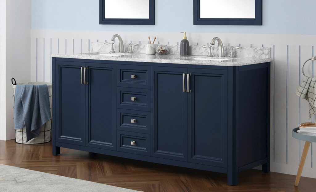 A dark blue bathroom vanity with double sinks and a granite countertop.