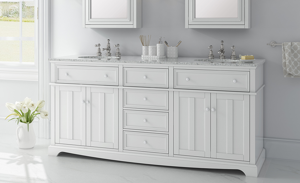 A white classic bathroom vanity with double sinks.
