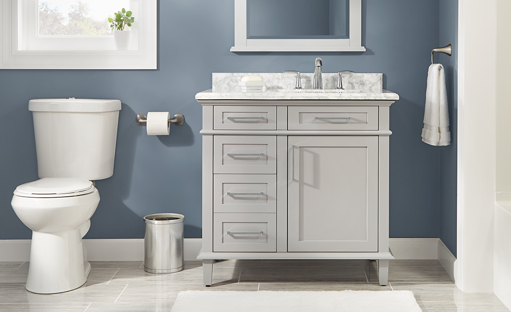 A transitional bathroom vanity with modern pulls and a classic furniture-style shape.