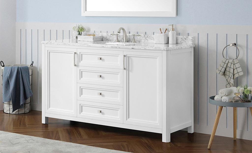 A white bathroom vanity with a spacious granite countertop.
