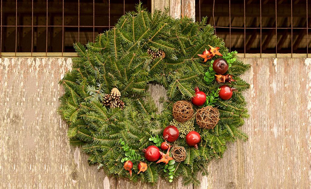 A hanging fresh-cut wreath.
