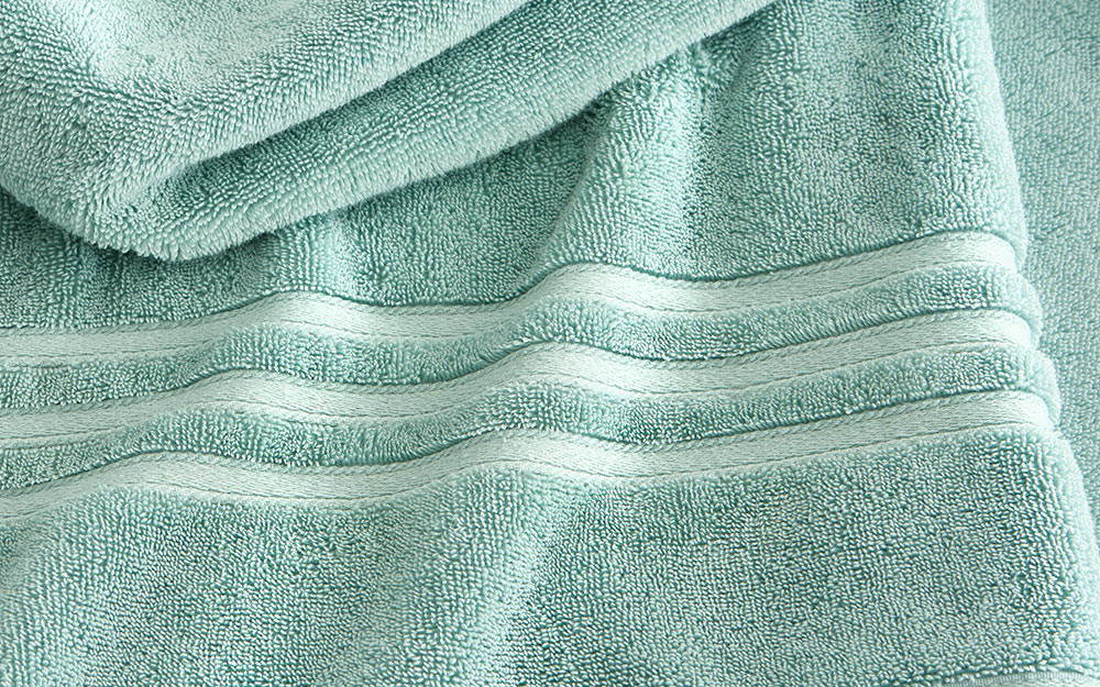 Green towel showing the cotton texture.