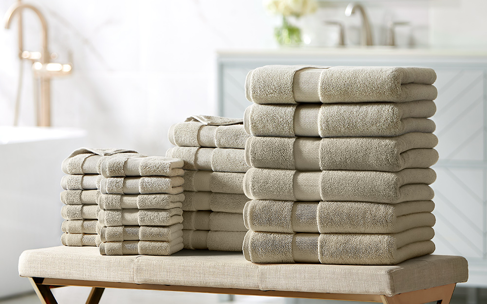 Stacks of gray towels in different sizes.