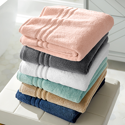 A stack of colorful bath towels on a vanity.