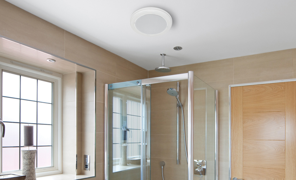 A decorative ceiling bathroom fan with a built-in light.