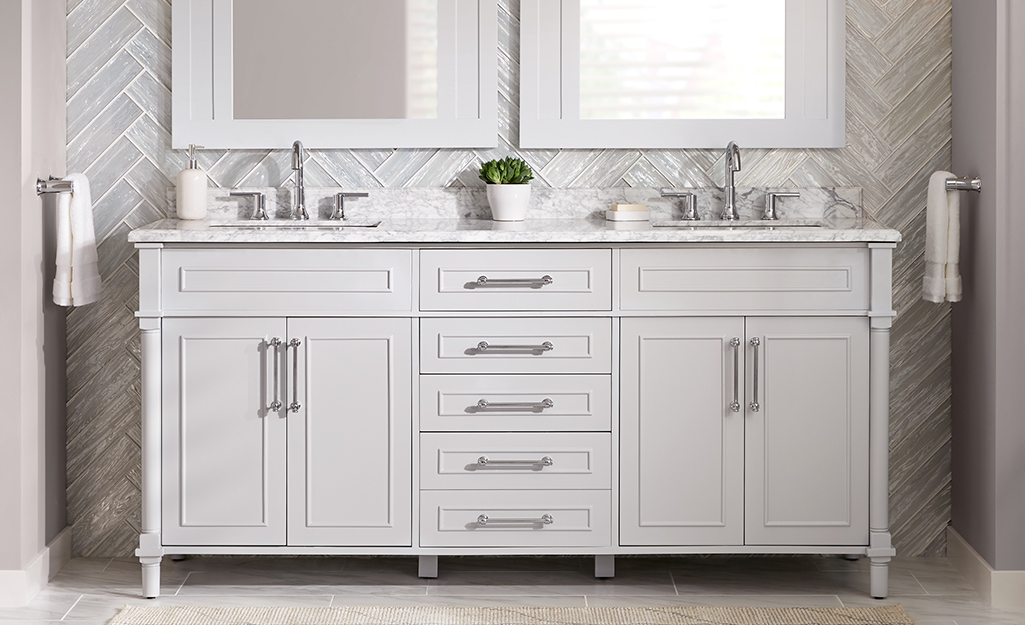 A light grey double vanity in a bathroom.