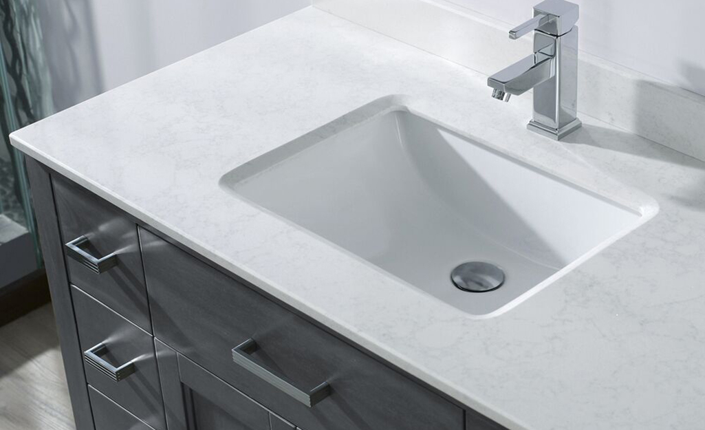 A bathroom vanity top made of solid surface material.