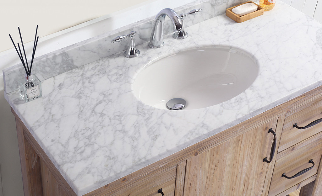 A bathroom countertop made of marble.