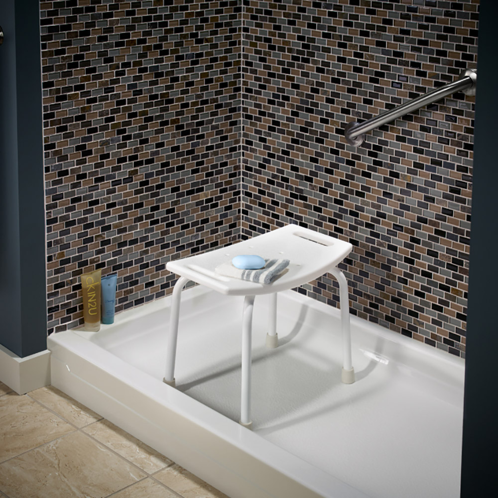 A bath seat sits in a shower with a grab bar.