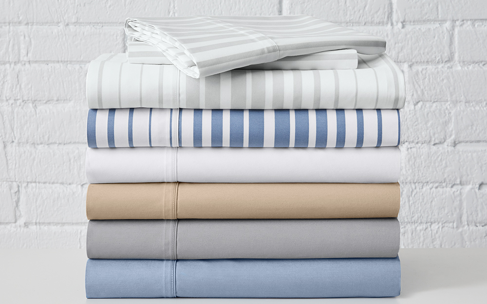 Striped sheets stacked on top of solid colored sheets.