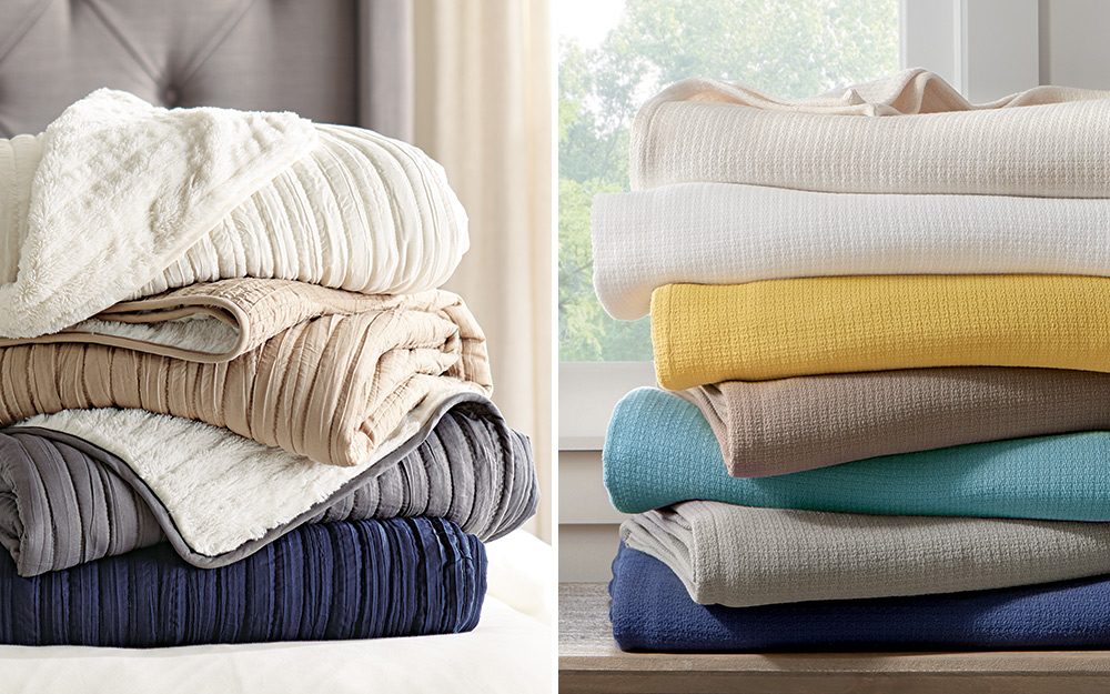 A stack of throws sits on the left side and a stack of blankets sits on the right.