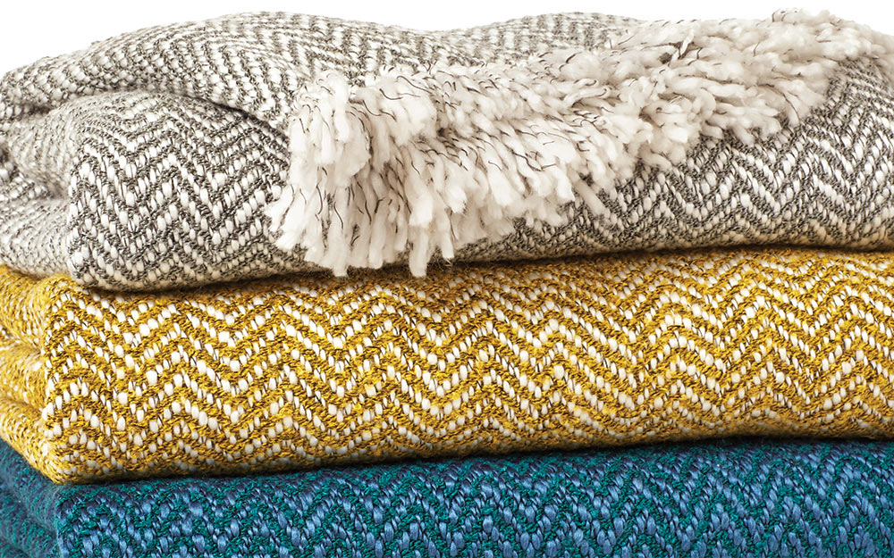 A detailed shot of multicolored throws.