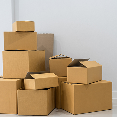 Stacks of cardboard moving boxes in various sizes.