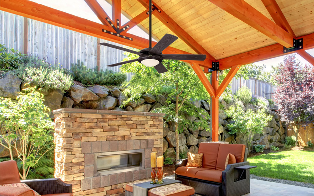 An outdoor fan installed on a covered patio.