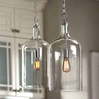 Two identical glass pendant lights.