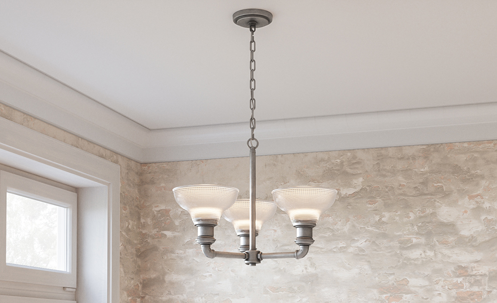 A classic chandelier with upward lighting.