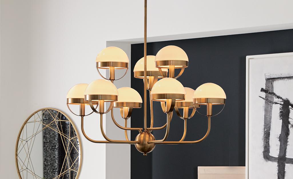 A brass mid-century modern chandelier.