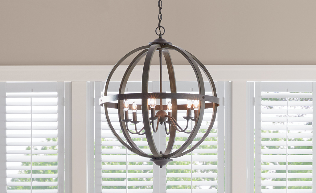 A coastal style cage chandelier.