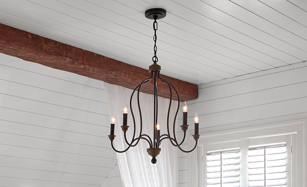 A cottage style candlestick chandelier.