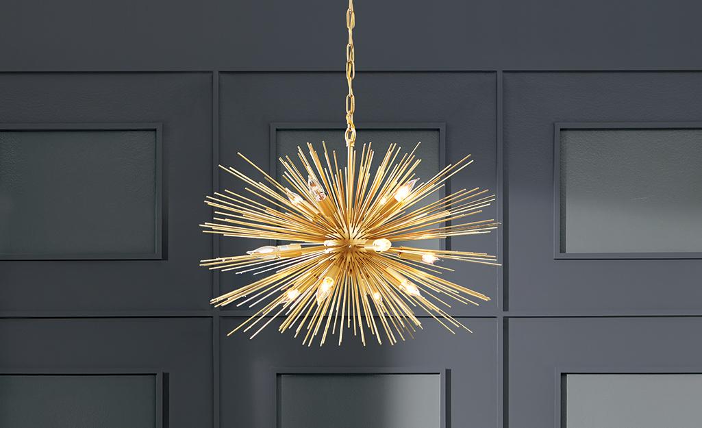 A gold starburst glam style chandelier.