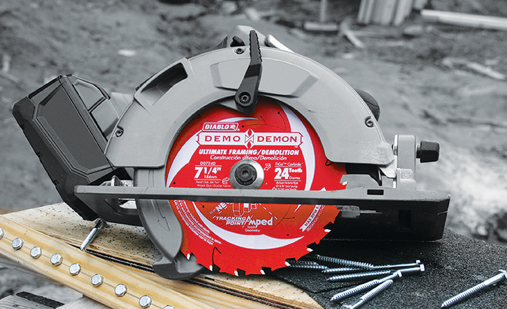 A circular saw showing a red blade on top of a work surface.