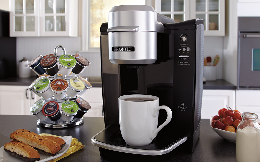 A coffee maker and a coffee cup in a kitchen
