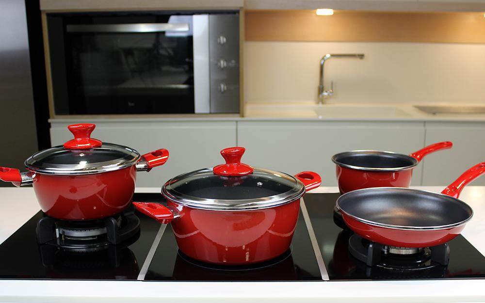 A porcelain enamel cookware set on a countertop