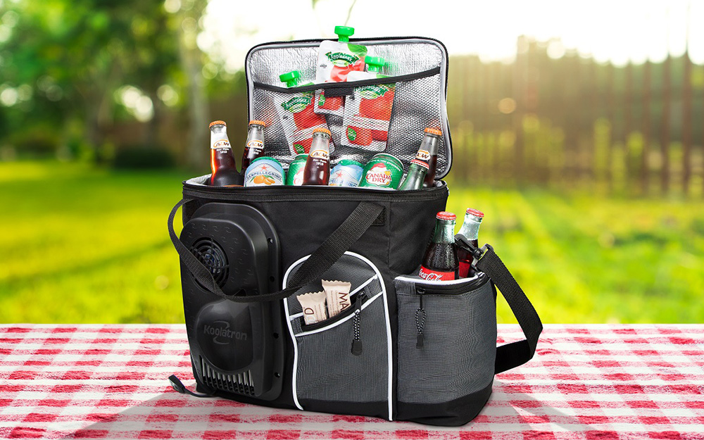 A soft-sided cooler full of snacks and drinks