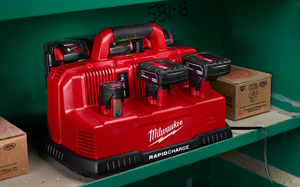 A charging station charging multiple batteries for cordless power tools.