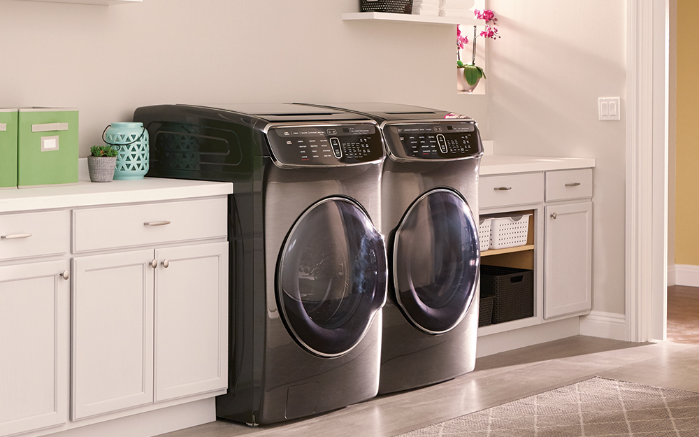 Matching front-load gas washer and dryer in a room.