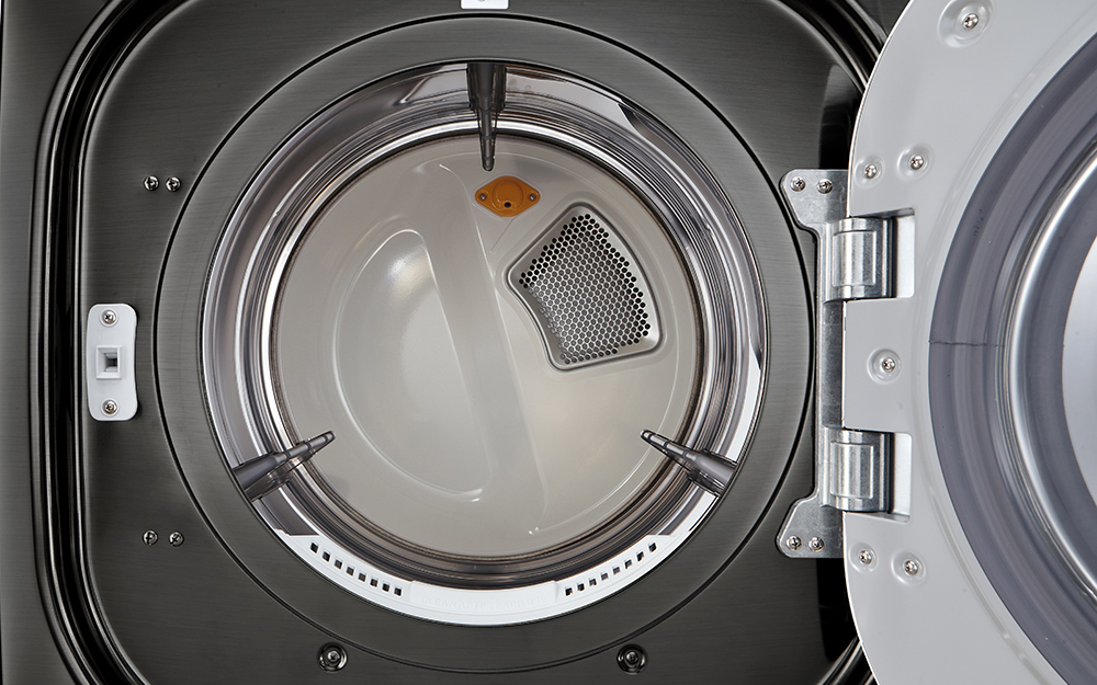 A look inside a front-load dryer with its door open.