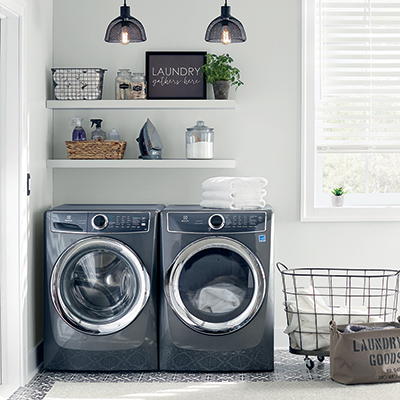 Washing machine and matching dryer in a laundry room by a window
