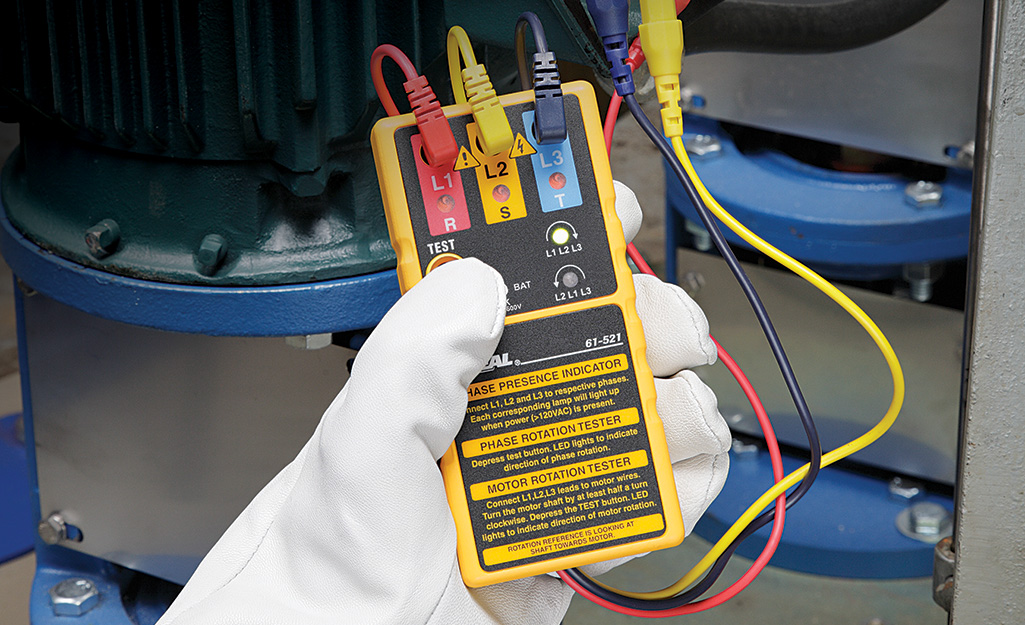Someone using an electric tester.