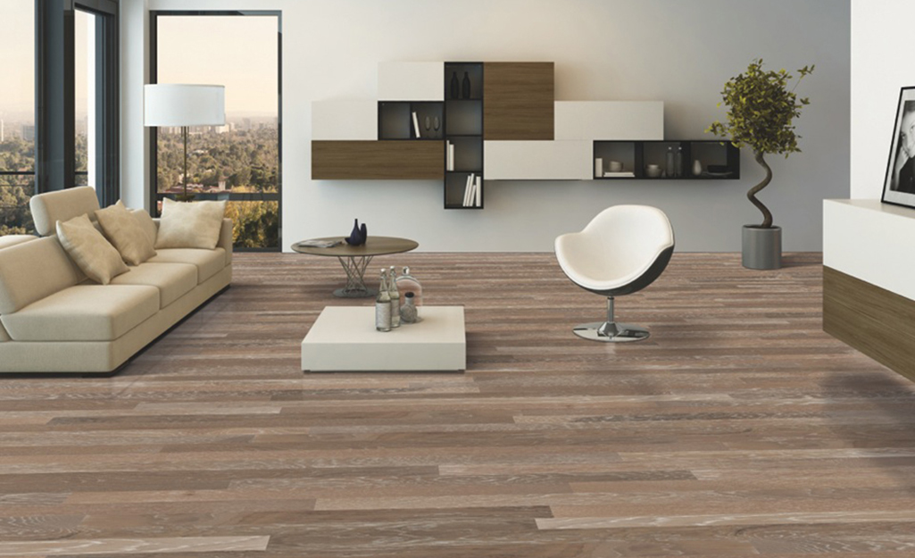 A modern style living room with thin engineered wood plank flooring.