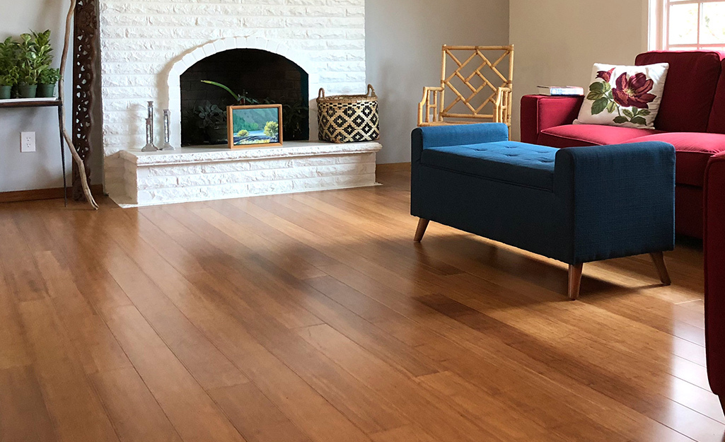 A living room with hickory engineered hardwood floors.
